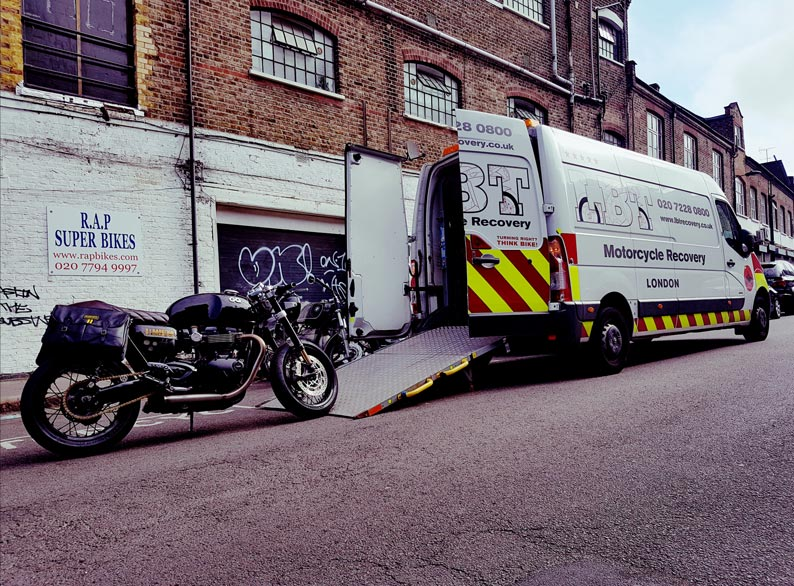 Large black bike being loaded | LBT Motorcycle Recovery