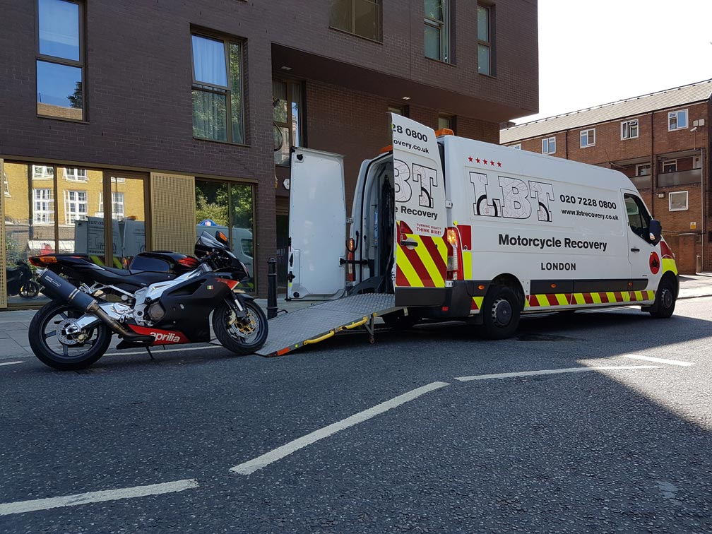 Bike in city being loaded | LBT Motorcycle Recovery