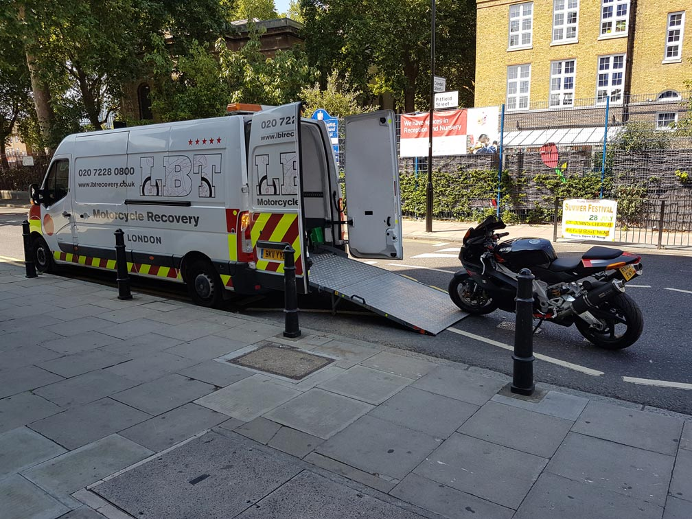 Black bike being loaded | LBT Motorcycle Recovery