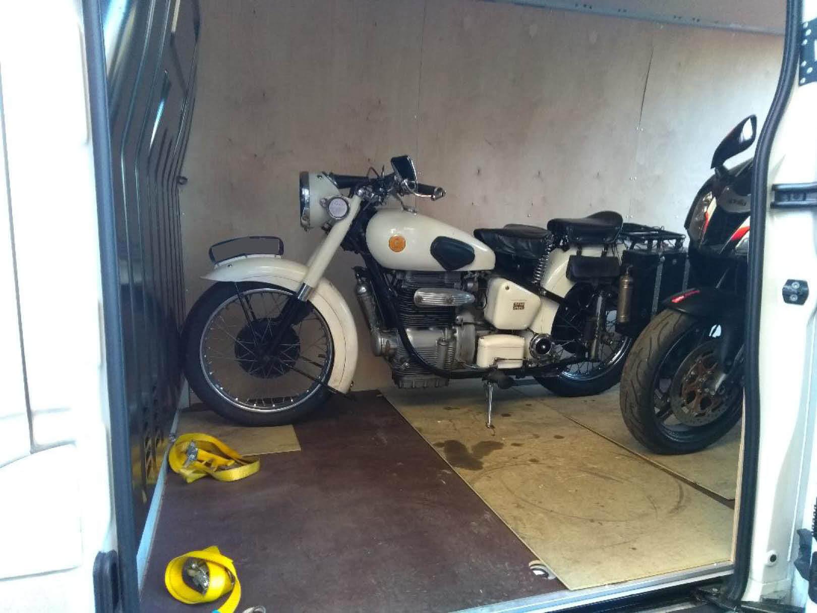 White bike loaded onto van | LBT Motorcycle Recovery