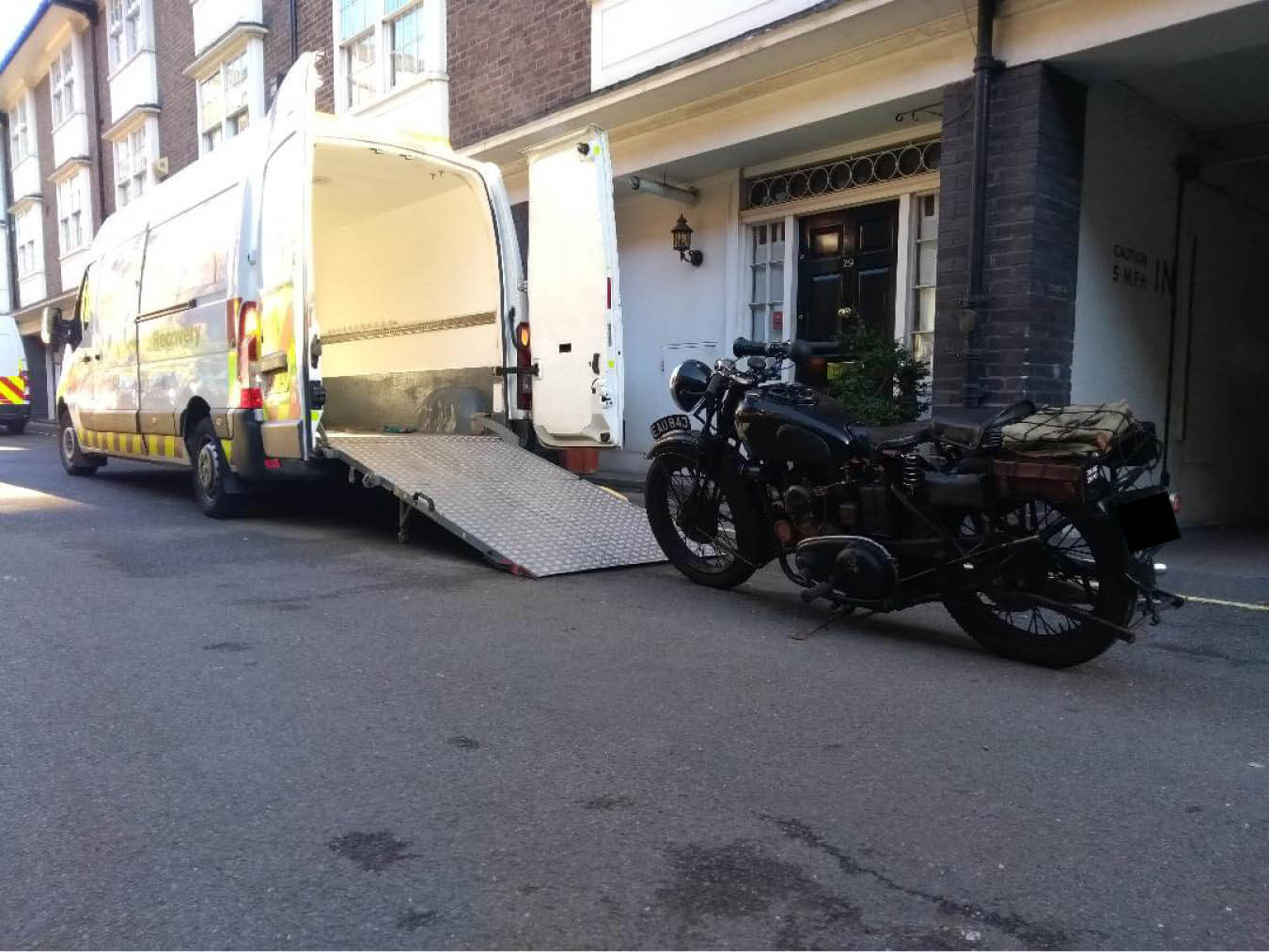 Van with ramp down to load large bike | LBT Motorcycle Recovery