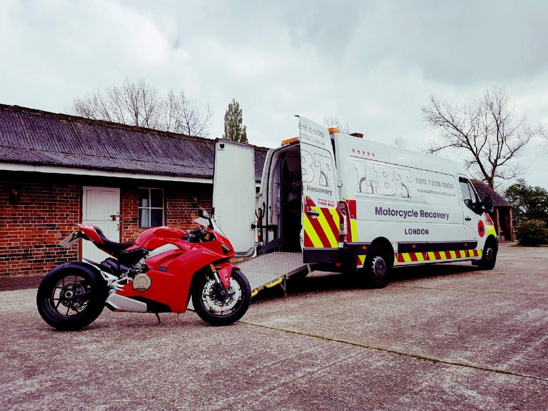 Red Ducati being loaded | LBT Motorcycle Recovery