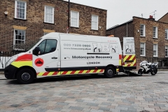 Loading outside brick houses  LBT Motorcycle Recovery   London 020 7228 0800