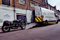 Large black bike being loaded   LBT Motorcycle Recovery