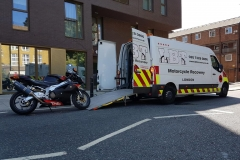 Bike in city being loaded   LBT Motorcycle Recovery