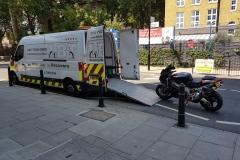 Black bike being loaded   LBT Motorcycle Recovery