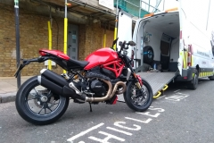 Red super bike being loaded | LBT Motorcycle Recovery