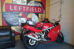 Red ducati in showroom | LBT Motorcycle Recovery