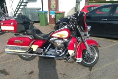 red bike with panniers | LBT Motorcycle Recovery
